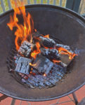 Starting the fire to burn down the wood into coals