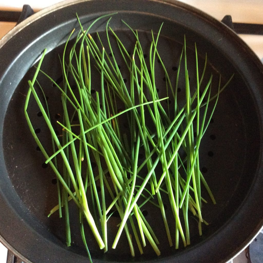 Look at these wonderful bright green chives that we will be adding a pinch of smokey flavor by our stove top smoked chives techniques