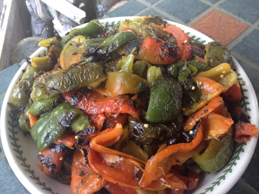 The bowl of finished ember cooked sweet peppers