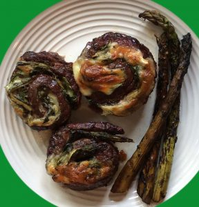 Our fully cooked plate of three Flank Steak Pinwheels with Cheese and Roasted Asparagus
