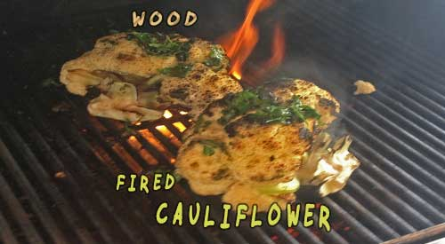 Look at this great head of cauliflower over wood chunks added to the grill!