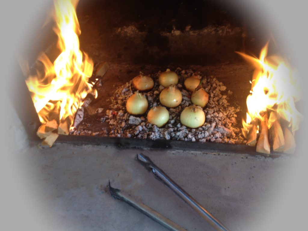 Roasted/Toasted Onions over Embers in a fireplace.