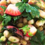Close up of radish salad with beans and parsley leaves