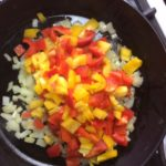 The peppers, onions and Potatoes in the skillet