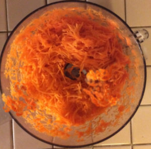 shredding carrots in the food processor makes it easy! Just don't overdue the process; need some pulp to the carrots