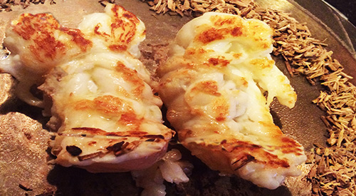 Wood Fired Lobster Tails with Ash Minuto® smoker wood chips on the Plancha stove-top grill