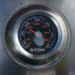 We maintain the temperature of our gas grill and approximately 275 degrees Farenheit.