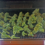 We are roasting our broccoli on the grates on the gas grill over a wood chunk placed on the diffuser.