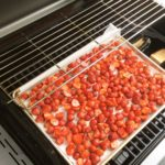 Strawberries on the gas grill with the double filet on the lite burner