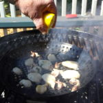 Grilling over the hottest part of the fire and spritz with lemon