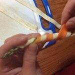 wrapping our Asparagus with carrot peel in preparation for the grill