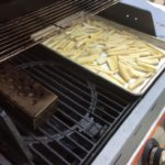 Our smoker box is all set on the lite side of the grill and the parsnips on the unlite!