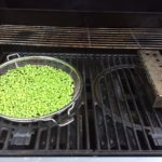 on peas on the cold side of the grill with the flame under our smoker box providing the smokey flavor