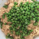ouir albacore tuna in a bowl with spices and peas added ready to mix
