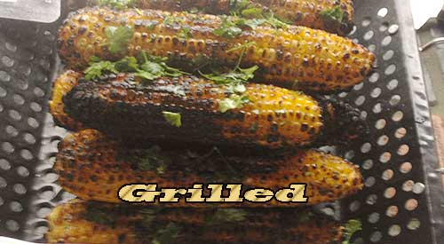 Wood flavoured grilled Corn on the Cob Topped with Fresh Parsley
