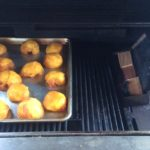 our tray of smoked peaches on the gas grill using a two zone cooking method to add wood smoke flavor.